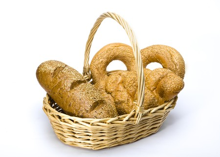 Basket with bread on white background photo