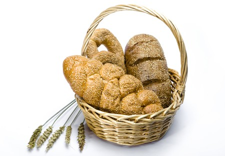 Basket with bread on white background Stock Photo - 7144604