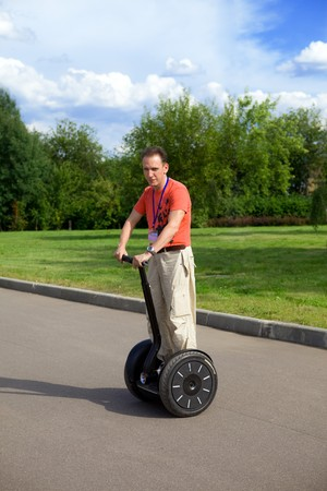 A man on an electric scooter-Segway .