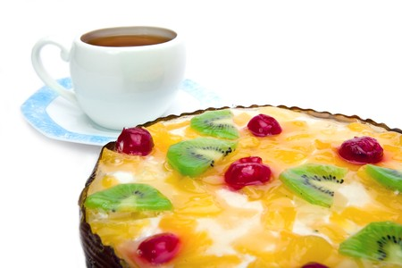 Pie fruit with cottage cheese and cup with saucer on white background photo