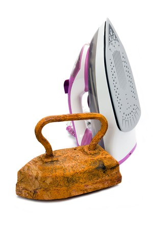new technologies: Old rusty pig-iron iron and modern new electric iron on white background