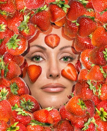Portrait of young woman, laying under strawberry   photo
