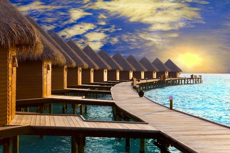 Maldives. Villa on piles on water at the time sunset. Stock Photo - 7423115