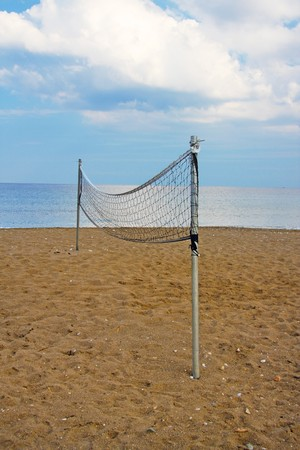 net  for beach volleyball on an empty beach Stock Photo - 7607506