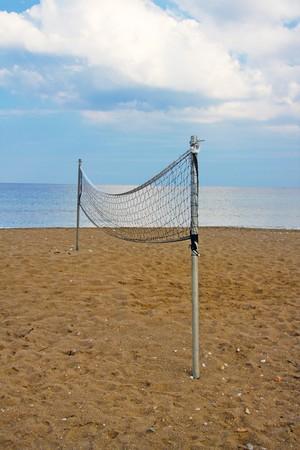 net  for beach volleyball on an empty beach Stock Photo - 7607506
