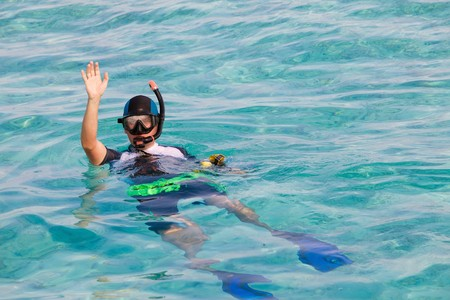 Man in flippers and mask in ocean, Maldives photo