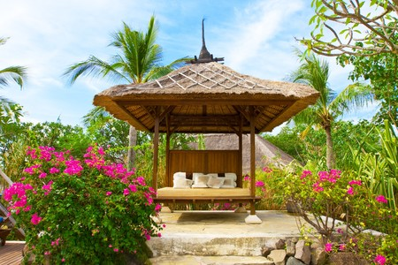 Pavilion for Spa procedures in tropical garden photo