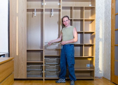 assemblage: The man is engaged in repair and furniture assemblage Stock Photo