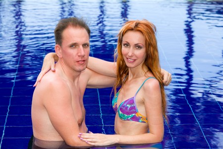 Young loving couple in pool photo