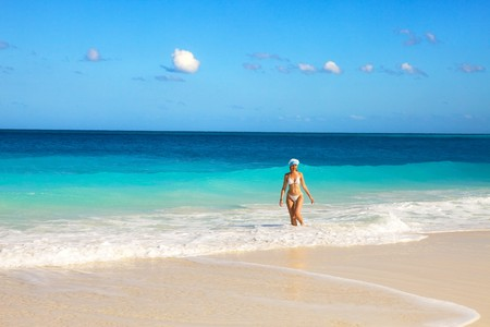 The girl on an ocean coast in the New Years cap,  photo