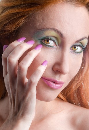 Portrait of the young woman with a make-up  and with long nails photo