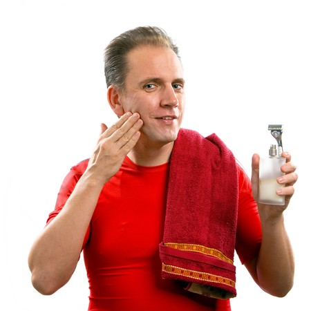 The well-groomed man uses balm after shaving photo