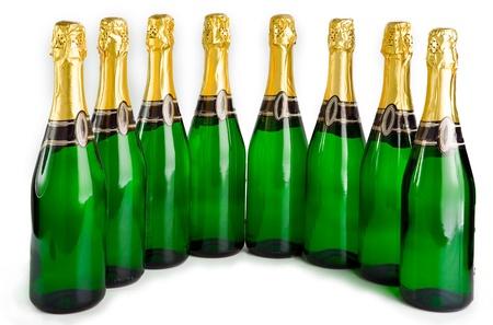 Sparkling wine bottles on a white background   photo