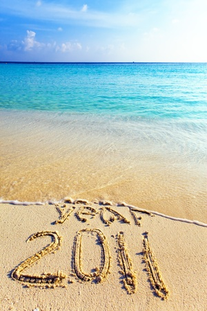 New 2011. The wave washes off an inscription 2010 Stock Photo - 8495833