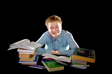 Pupil schoolboy with pile of textbooks  Stock Photo - 8555273