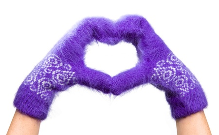 Valentine card- Hands in fluffy mittens are combined in the form of heart Stock Photo - 8607189