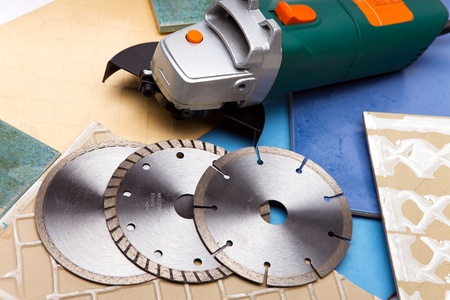 The machine for are sharp a tile and disks Stock Photo - 8608420