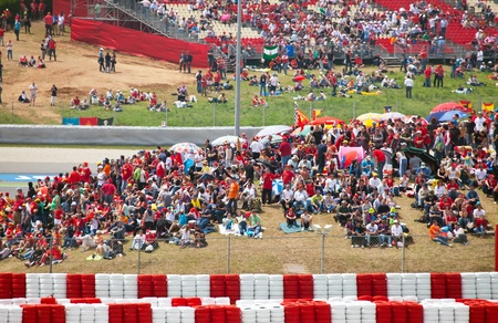 BARCELONA- MAY 9: Spectators on tribunes on The Formula 1 Grand Prix on may 9, 2010 in Barcelona, Spain