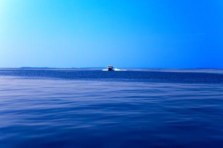 boundless: Boat at boundless ocean