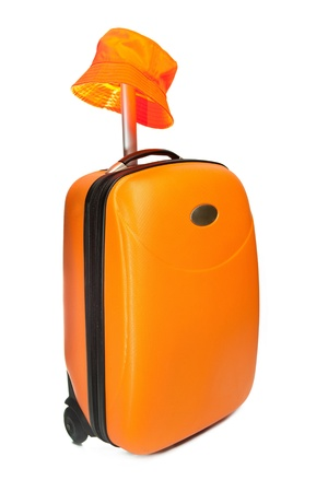 Orange suitcase for travel and a hat Stock Photo - 9139533