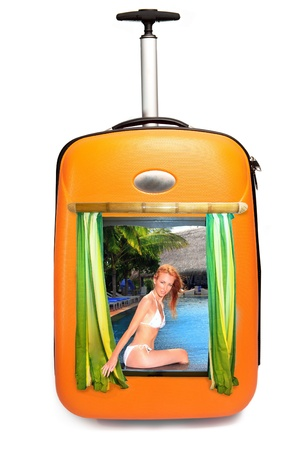 The girl in bikini looks out of a suitcase and invites to rest Stock Photo - 9139534