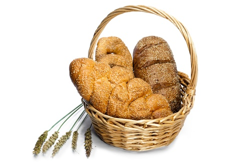Basket with bread on white background Stock Photo - 9292557