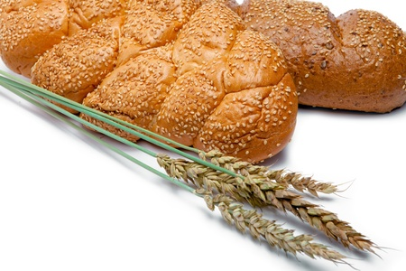 Wheat and bread on white background Stock Photo - 9292586