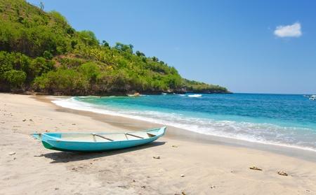 Indonesia. Bali.  boat on an ocean coast photo