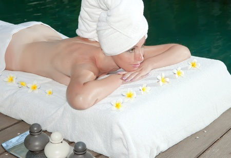 The young beautiful woman on Spa procedures in pool Stock Photo - 9750579