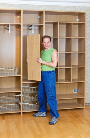 assemblage: The man is engaged in repair and furniture assemblage