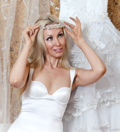 The happy bride tries on a wedding dress Stock Photo - 9751109