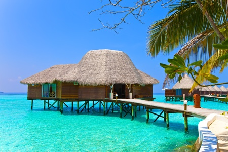 Island in ocean, overwater villa.Maldives.  Editorial