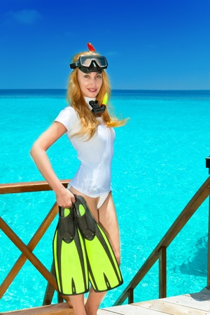 Young pretty woman with flippers, mask and tube. Maldives. Stock Photo - 9997459