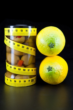 healthy food -  olive and lemons support a harmonous figure   photo