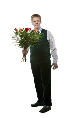 The pupil  in a school uniform with a bouquet of flowers   photo
