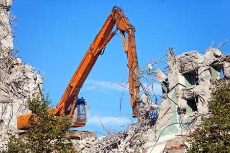 The dredge destroys an old building photo