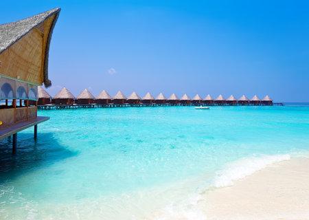 Island in ocean, overwater villas  Редакционное