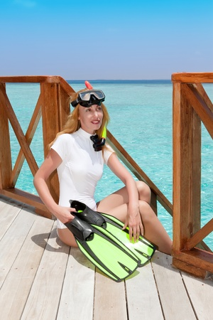 Young pretty woman with flippers, mask and tube  photo