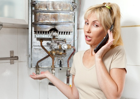 house call: The young woman the housewife calls in a workshop on repair of gas water heaters