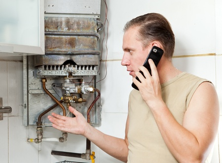 broken telephone: The man calls by phone to cause the repairman of gas water heaters