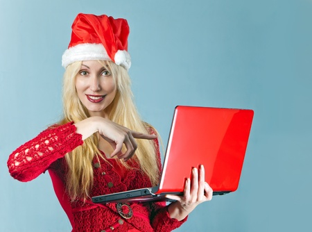 The blonde in a New Years hat and with the red laptop   photo