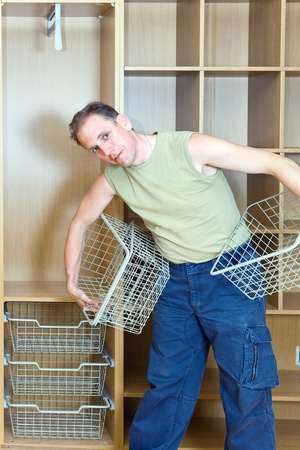 The man establishes baskets in a new wardrobe photo