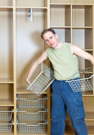 capacious: The man establishes baskets in a new wardrobe