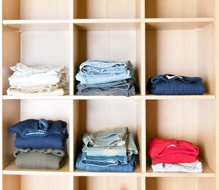vestibule: Clothes on regiments in a wardrobe Stock Photo