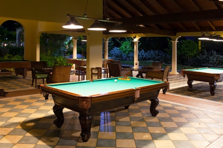 snooker table: Table for game in a pool on a street terrace, evening Editorial