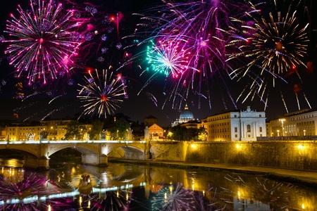 tiber: Celebratory fireworks over bridge Vittorio Emmanuel through Tiber. Italy. Rome.   Stock Photo
