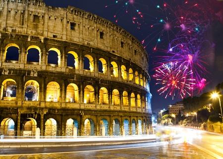 Celebratory fireworks over Collosseo. Italy. Rome Фото со стока