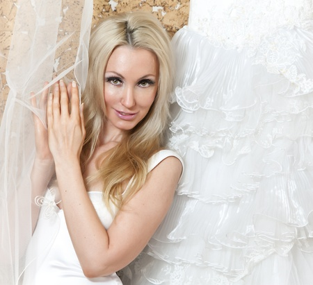 ruching: The happy bride tries on a wedding dress Stock Photo