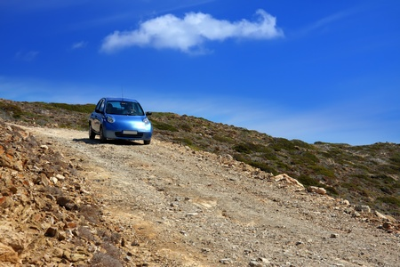 The car on a dirt road on a mountain slope. Greece. Rhodes   photo