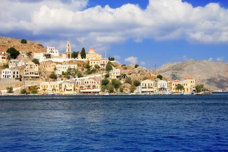 Greece. Dodecanesse. Island Symi (Simi). Colorful houses on rocks. Stock Photo - 12923534